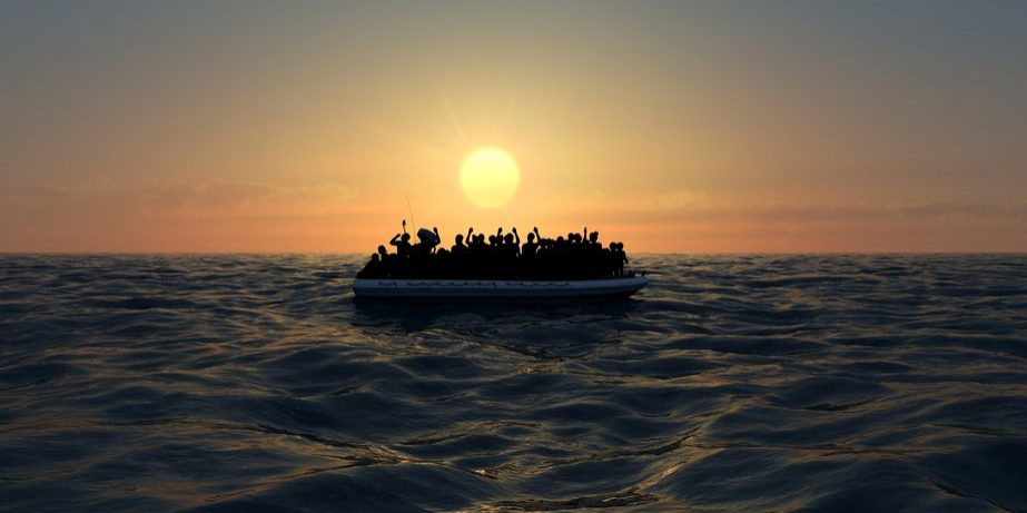 116523880 - refugees on a rubber boat in the middle of the sea that require help. sea with people asking for help. migrants crossing the sea